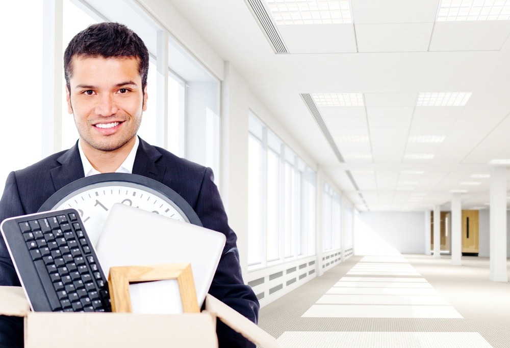 Businessman moving into a new office holding a box.jpeg